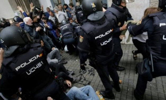 © AFP | Shocking scenes of riot police using batons and rubber bullets to remove people from polling stations on October 1, the day of the referendum that was banned by the courts made headlines around the world and fuelled tensions in Catalonia.