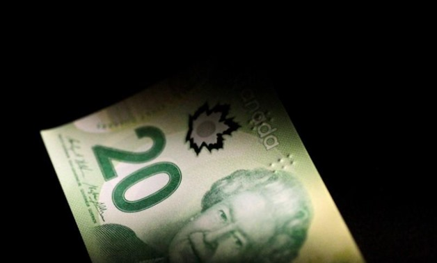 A Canada Dollar note is seen in this June 22, 2017 illustration photo - REUTERS/Thomas White/Illustration