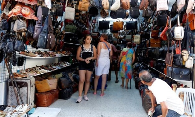 Russian tourists are seen shopping at the old medina in Sousse, Tunisia, September 30, 2017 - REUTERS/Zoubeir Souissi