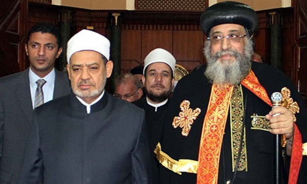 FILE - Pope Tawadros II of Alexandria and Al-Azhar Grand Imam Ahmed al-Tayeb