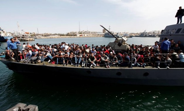 Illegal migrants arrive by boat at a naval base after they were rescued by Libyan coastguard in the coastal city of Tripoli, Libya, May 10, 2017. REUTERS/Ismail Zitouny