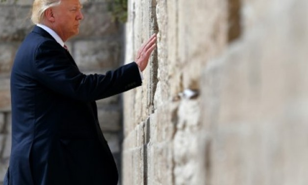 © AFP/File | Israel is to name a planned new railway station close to Judaism's hallowed Western Wall in annexed east Jerusalem after US President Donald Trump, seen here visiting the site on May 22, 2017