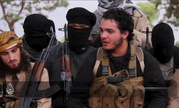 An Islamic State militant who identifies himself as Abu Salman (2nd R) speaks at an undisclosed location, in this still image taken from undated video distributed by Islamic State on November 14, 2015. REUTERS/Social Media Website via Reuters TV
