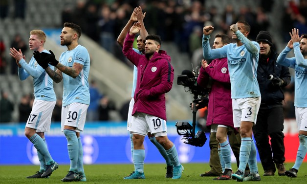 Soccer Football - Premier League - Newcastle United vs Manchester City - St James' Park, Newcastle, Britain - December 27, 2017 Manchester City's Sergio Aguero celebrates with Fernandinho, Nicolas Otamendi, Kevin De Bruyne and teammates after the game REU