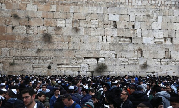 Orthodox Jews gather at the Western Wall in the Old City of Jerusalem on December 28, 2017 to pray for rain - AFP