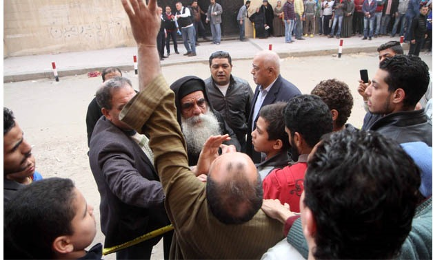 A civilians reacts to a terrorist attack targeted police personnel and Copts outside the Church of Martyr Mina in Helwan city, southern Cairo, on Friday, December 29, 2017- Egypt Today/ Hassan Mohamed