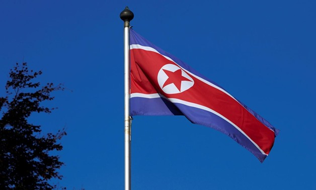 FILE PHOTO - A North Korean flag flies on a mast at the Permanent Mission of North Korea in Geneva October 2, 2014. REUTERS/Denis Balibouse