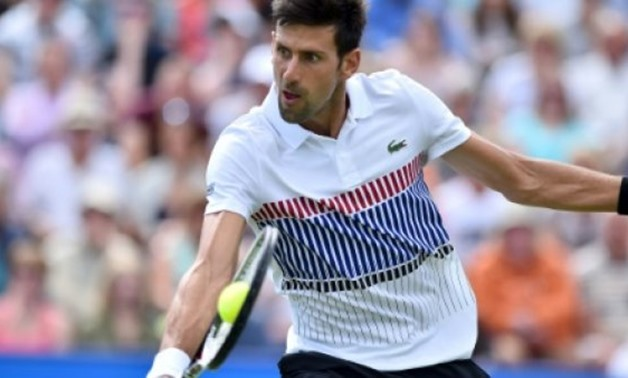 © AFP/File / by David HARDING | Novak Djokovic, the champion in Doha for the past two years, has pulled out of the Qatar Open because of continuing problems with a niggling elbow injury