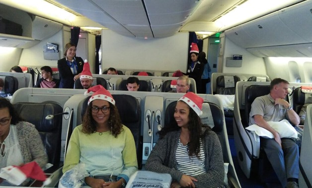 EgyptAir distributes gifts to passengers to mark New Year - Press Photo
