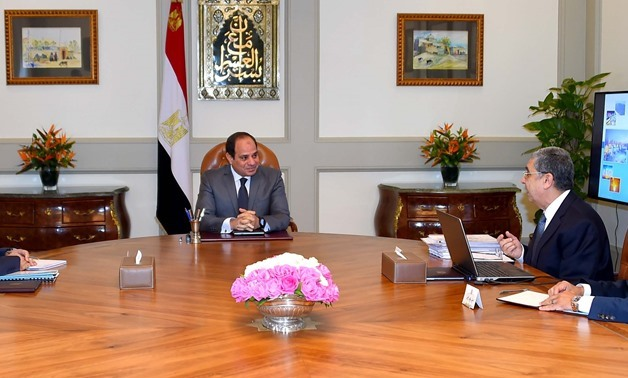 President Abdel Fatah al-Sisi (M) heads a meeting with Mostafa Madbouly (L), acting Prime Minister, and Mohamed Shaker (TR), Minister of Electricity and Renewable Energy, in the presence of Presidential Spokesperson, Bassam Rady (BR) – Courtesy of the Pre