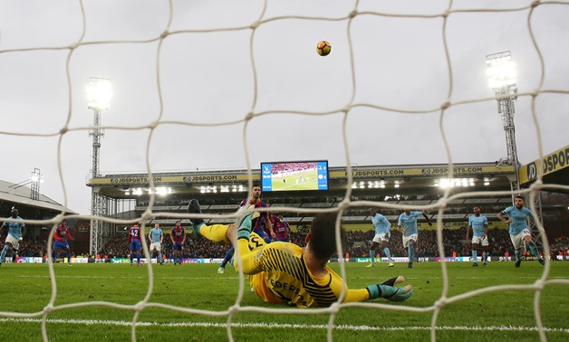 Soccer Football - Premier League - Crystal Palace vs Manchester City - Selhurst Park, London, Britain - December 31, 2017 Manchester City's Ederson saves a penalty from Crystal Palace's Luka Milivojevic REUTERS/David Klein