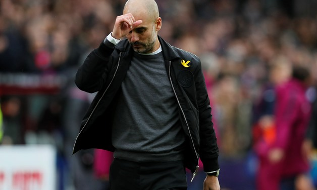 Soccer Football - Premier League - Crystal Palace vs Manchester City - Selhurst Park, London, Britain - December 31, 2017 Manchester City manager Pep Guardiola reacts after the match REUTERS/David Klein 