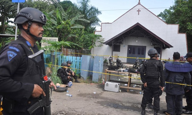 Police stand near the scene of an explosion outside a church in Samarinda, East Kalimantan, Indonesia November 13, 2016 in this photo taken by Antara Foto.
