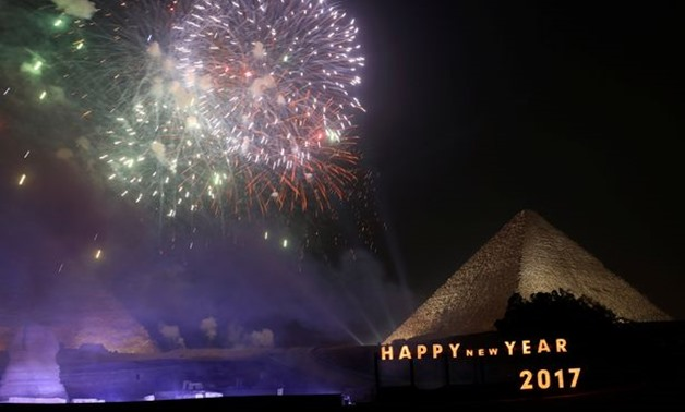 Fireworks explode above the pyramids during New Year's day celebrations on the outskirts of Cairo - REUTERS
