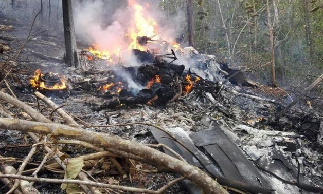 Smoke and fire seen at the site where a plane crashed in the mountainous area of Punta Islita, in the province of Guanacaste, in Costa Rica December 31, 2017 in this picture obtained from social media. Ministerio de Seguridad Publica de Costa Rica/via REU