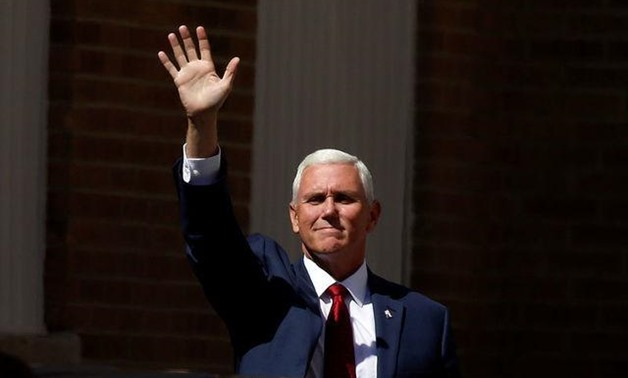 Mike Pence waves at supporters as he arrives at a campaign rally in Scranton, Pennsylvania, U.S., July 27, 2016. REUTERS/Carlo Allegri