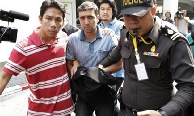 Thai police officers escort Iranian suspect Mohammad Khazaei (C), 42, at the Immigration Bureau in Bangkok February 16, 2012. REUTERS/Chaiwat Subprasom.