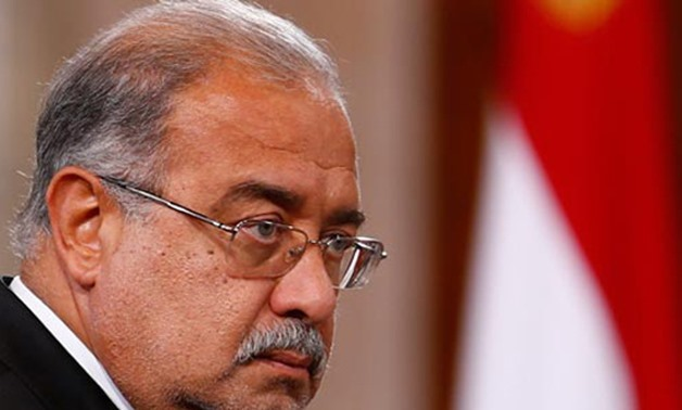 FILE – Prime Minister Sherif Ismail, who also heads the Egyptian Disputes Settlement Committee