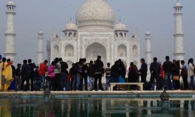 Crowds gather to visit the Taj Mahal: India is to restrict the number of daily visitors - AFP