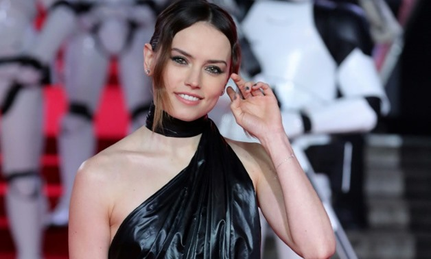 "British actress Daisy Ridley, a star of ""Star Wars: The Last Jedi,"" poses on the red carpet for the European Premiere of the film at the Royal Albert Hall in London on December 12, 2017"