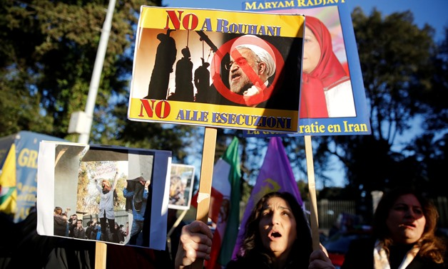 Opponents of Iranian President Hassan Rouhani hold a protest outside the Iranian embassy in Rome, Italy, January 2, 2018. REUTERS/Tony Gentile