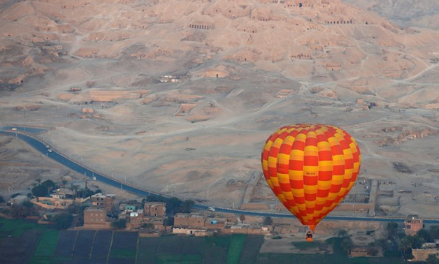 A hot-air balloon flies over the village of al-Qurna, situated over a necropolis of more than 500 pharaonic tombs at the feet of the Theban Mountains, in the city of Luxor, south of Cairo, Egypt December 13, 2016 – Reuters/Amr Abdallah Dalsh