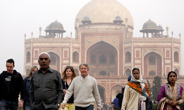 Domestic and foreign tourists walk in front of Humayun's Tomb, one of the tourist destinations in New Delhi, India, January 1, 2018. Picture taken January 1, 2018. REUTERS/Saumya Khandelwal