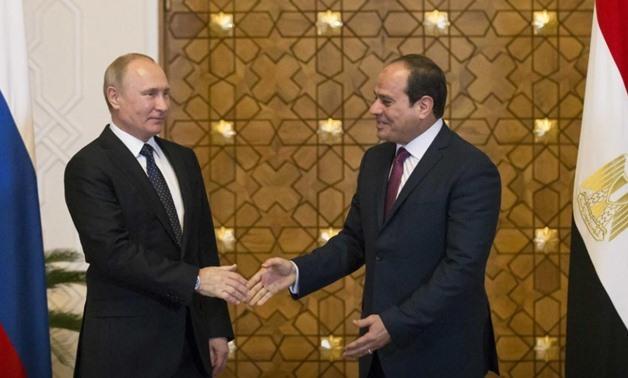 FILE- Egyptian President Abdel Fatah al-Sisi and Russian counterpart Vladimir Putin in Cairo – Reuters