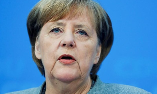 FILE PHOTO: Acting German Chancellor Angela Merkel address a news conference at the Christian Democratic Union (CDU) party headquarters in Berlin, Germany, December 18, 2017. REUTERS/Hannibal Hanschke