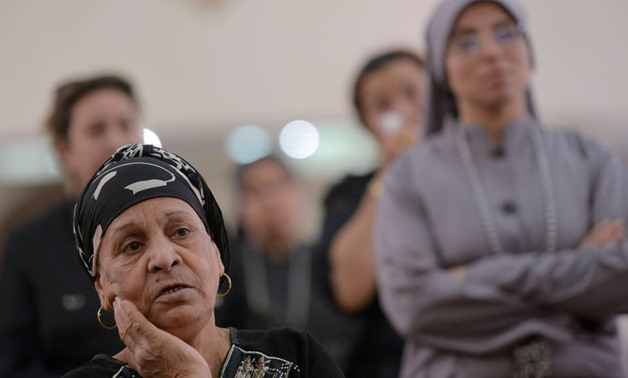 Egyptians attend mass at the St Mark Coptic Orthodox Cathedral in the Bani Mazar province, in the Minya governorate. Mohamed El Shahed / AFP