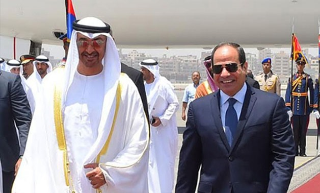 Abu Dhabi's Crown Prince Sheikh Mohamed bin Zayed with Egyptian President Abdel Fattah El-Sisi at Cairo Airport in November 2016 – Egyptian Presidency/File photo