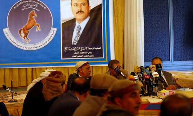 Members of the General People's Congress party, once headed by Yemen's slain former president Ali Abdullah Saleh (pictured in poster), attend a meeting of the party's leadership in Sanaa, Yemen January 7, 2018. REUTERS/Khaled Abdullah