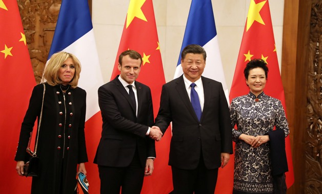 French President Emmanuel Macron (2ndL) and his wife Brigitte Macron (L) pose with China's President Xi Jinping (2ndR) and his wife Peng Liyuan (R) during their meeting in Beijing, China January 8, 2018. REUTERS/Ludovic Marin/Pool