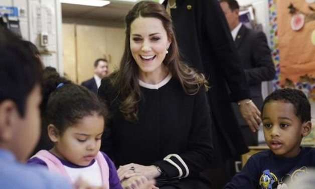 Kate Middleton, the Duchess of Cambridge, laughs while sitting next to April age 4, (L), and Sammy age four, in a pre-school class, December 08, 2014 03:49pm EST - Seth Wenig-Pool/Getty Images
