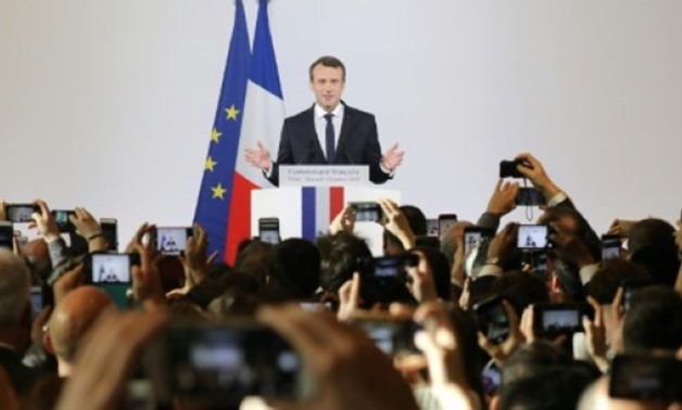AFP / by Laurence BENHAMOU, Patrick BAERT | French President Emmanuel Macron Macron, who has become the leading voice of the European Union, endorsed President Xi Jinping's massive $1 trillion programme to revive ancient Silk Road trading routes during hi
