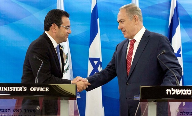 Guatemalan President Jimmy Morales and Israeli Prime Minister Benjamin Netanyahu shake hands during their meeting in Jerusalem as they deliver statements to the media November 29, 2016 – REUTERS/Abir Sultan