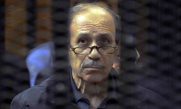 FILE –The former Interior Minister, Habib Al Adly in court accompanied by officers