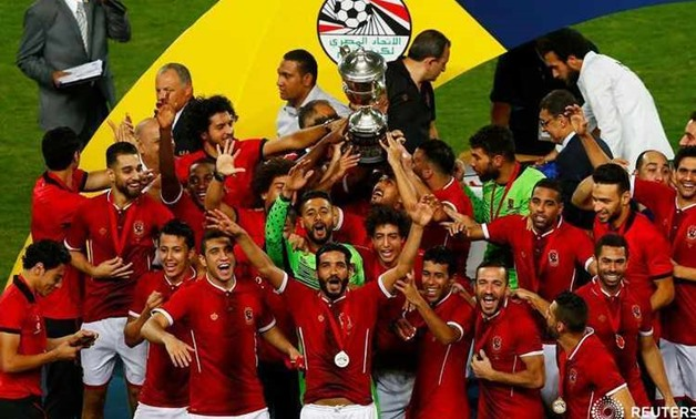 Soccer Football - Egyptian Cup Final - Al Masry v Al Ahly - Alexandria, Egypt - August 15, 2017 Al Ahly players celebrate winning the Egyptian Cup with the trophy REUTERS/Amr Abdallah Dalsh