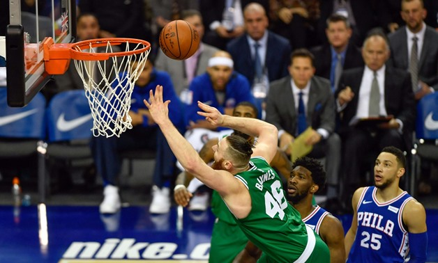 Jan 11, 2018; London, ENG; Boston Celtics Centre Aron Baynes (46) is fouled by Philadelphia 76ers Centre Joel Embiid (21) during the first quarter of the game at The O2 Arena. Mandatory Credit: Steve Flynn-USA TODAY Sports