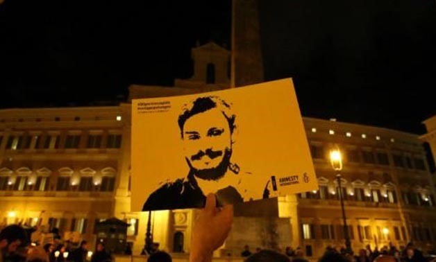 : A man holds a placard during a vigil to commemorate Giulio Regeni, who was found murdered in Cairo a year ago, in downtown Rome, Italy January 25, 2017. REUTERS/Alessandro Bianchi
