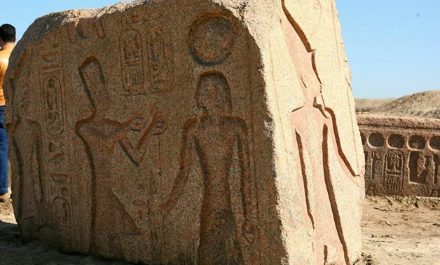 A stela carved in red granite depicting 19th Dynast King Ramses II presenting offerings to an ancient Egyptian deity – Ministry of Antiquities Facebook page