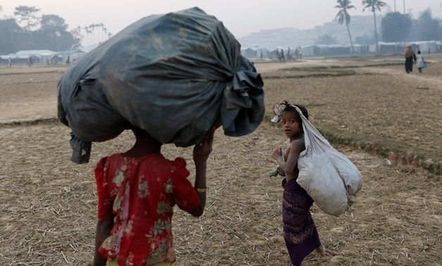 Rohingya refugee children walk inside Balukhali camp, near Cox's Bazar, Bangladesh January 12, 2018. REUTERS/Tyrone Siu