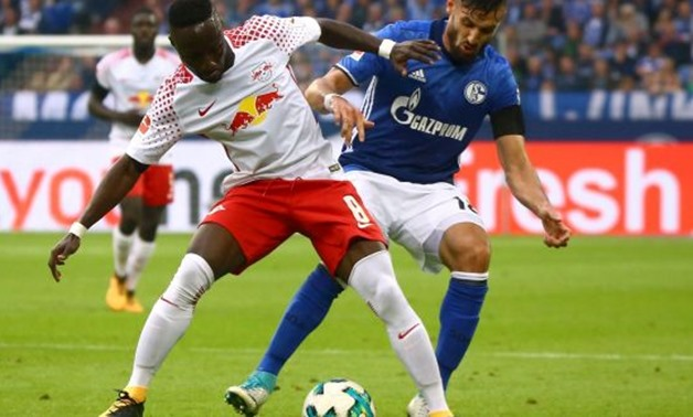 Soccer Football - Bundesliga - Schalke 04 vs RB Leipzig - Gelsenkirchen, Germany - August 19, 2017 Schalke's Daniel Caligiuri in action with RB Leipzig's Naby Keita REUTERS/Wolfgang Rattay