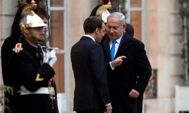 File photo: French President Emmanuel Macron speaks with Israeli Prime Minister Benjamin Netanyahu following a meeting at the Elysee Palace in Paris, France December 10, 2017. REUTERS/Philippe Wojazer