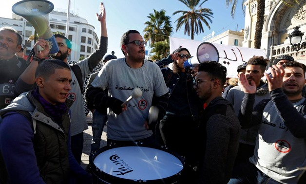 A demonstrator hits a drum during protests against rising prices and tax increases in Tunis, Tunisia January 13, 2018. REUTERS/Zoubeir Souissi
