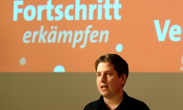 Kevin Kuehnert, head of the German Social DemocratsÕ (SPD) youth wing urges delegates to the partyÕs regional congress in the state of Saxony Anhalt not to back another four years of coalition with German Chancellor Angela Merkel during a meeting in Werni