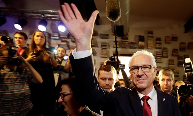 Czech presidential candidate Jiri Drahos waves to his supporters, after polling stations closed for the country's direct presidential election, in Prague, the Czech Republic January 13, 2018. REUTERS/David W Cerny