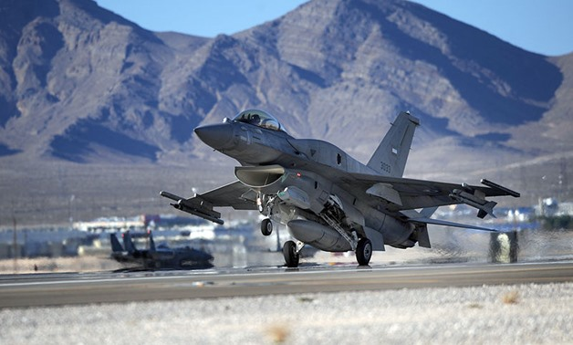 FILE - An F-16E from Al-Dhafra Air Base, United Arab Emirates, lands at Nellis Air Force Base - U. S. Air Force/ Michael R. Holzworth