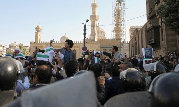 People chant slogans in front of al-Azhar mosque during a protest against Trump's Jerusalem declaration, in Old Cairo, Egypt December 8, 2017. Reuters