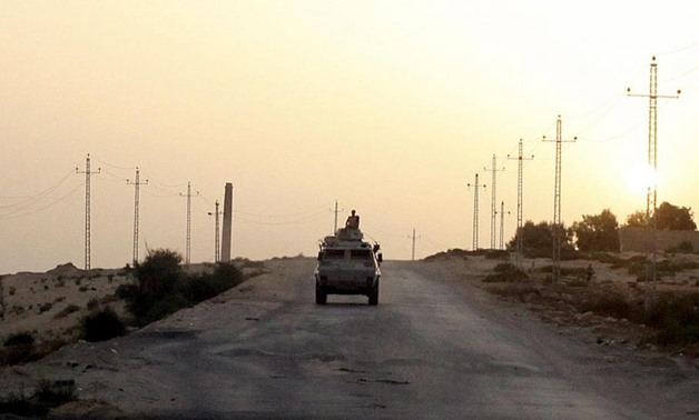 Caption: An Egyptian military vehicle is seen on the highway in northern Sinai, Egypt, in this May 25, 2015 file photo. REUTERS/Asmaa Waguih/Files